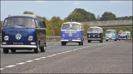 A convoy of VW camper vans on the M23