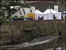 Police search teams at the river