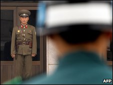 North Korean soldier stares at a South Korean soldier at Panmunjom in the demilitarised zone