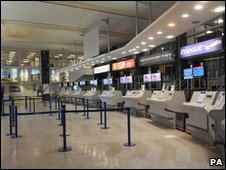 Empty check-in desks at Manchester Airport