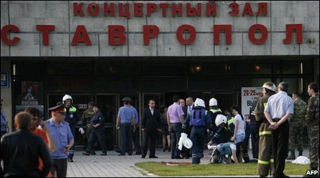 Emergency workers help injured people outside the concert hall in Stavropol, 26 May