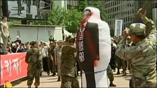 Protesters attacking effigy of North Korean leader