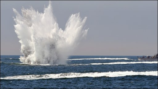 A South Korean patrol boat drops a depth charge during a naval drill