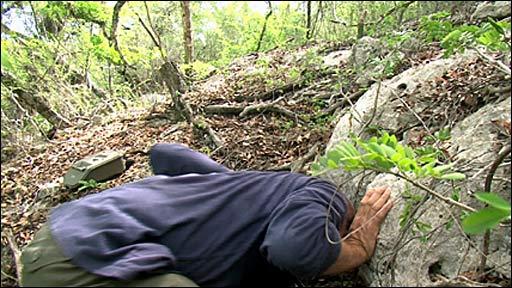 Joe Nunez-Mino sniffing a cave