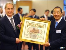 Prudential chairman Harvey McGrath (L) and Ronald Arculli, chairman of the Hong Kong Exchange