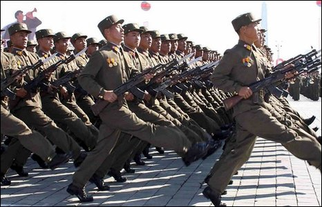 North Korean People's Army soldiers marching at Kim Il-Sung Square in Pyongyang in a military parade to mark the 60th anniversary of the Workers' Party of Korea