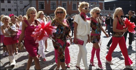 Blonde women march through Riga, Latvia, 29 May