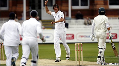 Steven Finn celebrates taking the wicket of Bangladesh's Junaid Siddique