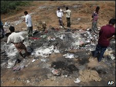 People gather at the site of the  accident