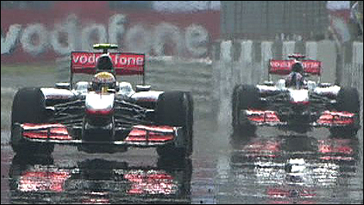 Lewis Hamilton crosses the finish line ahead of team mate Jensen Button