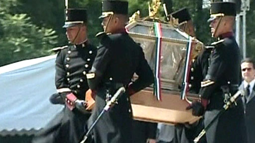 Remains are carried by soldiers