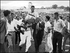 Joe Gaetjens (C) is carried off the pitch by cheering fans after US win, 28 June 1950