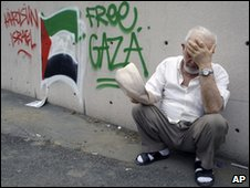 A Turkish man next to anti-Israeli graffiti in Istanbul on 31 May 2010