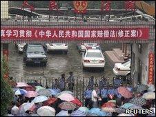 People outside Lingling District People's Court in Yongzhou, Hunan, China (1 June 2010)