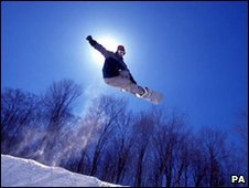 Snowboarder jumping in mid air