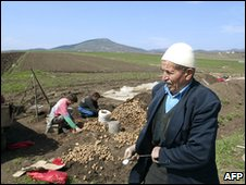 Kosovars harvesting potatoes