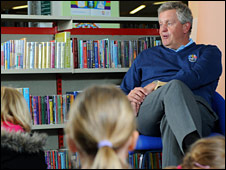 Colin Montgomerie wins new Welsh friends as he reads to children at Newport Library in the build-up to the 2010 Wales Open