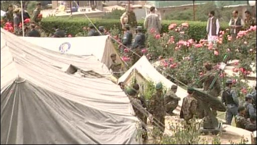 Troops and officials outside a tent in Afghanistan
