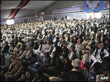 "Delegates look on as Afghan President Hamid Karzai delivers a speech at the ""peace jirga"""