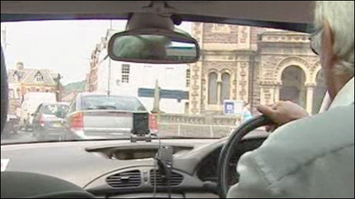 Nigel Webb at the wheel of his cab, with the camera on the dashboard