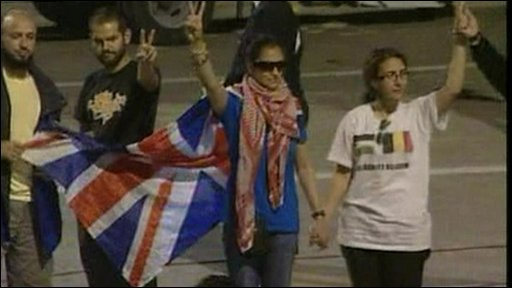 Activists at Istanbul airport, one wearing a union jack flag