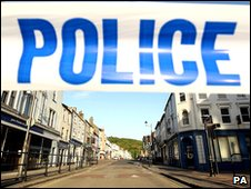 Police tape seals off a street in Whitehaven
