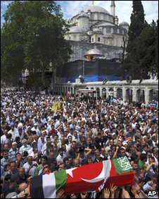A coffin is carried through the crowd to the Fatih mosque in Istanbul, 3 June