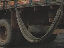 A dirty hammock slung from a truck