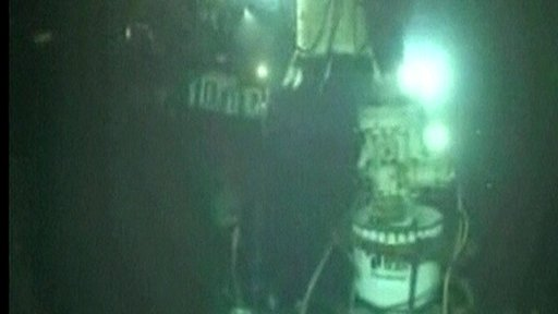 Still from underwater camera of attemps to cap the oil leak