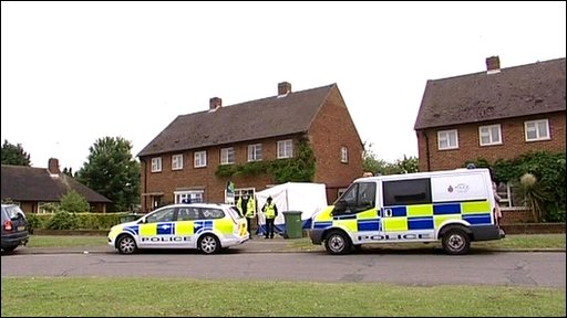 Police outside the house in Cobham.