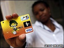 Woman holds World Cup branded Visa card