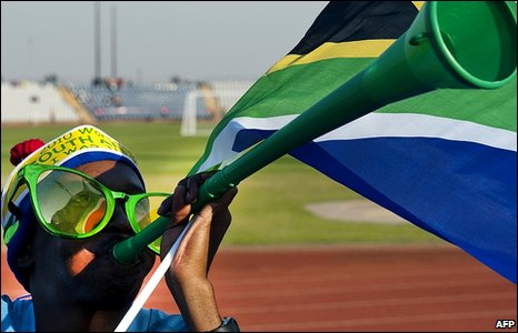 A Sowetan plays the vuvuzela at the Dobsonville Stadium