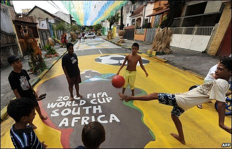 Children play football in a street of Rio de Janeiro, Brazil, decorated with colours of the Brazilian football team and themes from Africa, ahead of the Fifa 2010 World Cup in South Africa