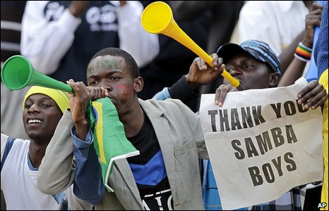Football fans cheer from the grand stand prior to the friendly match between Brazil and Zimbabwe in Harare, Zimbabwe