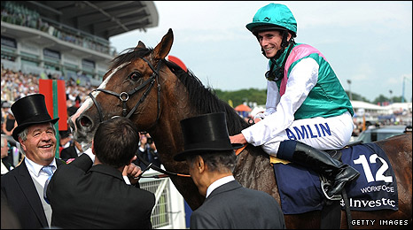Ryan Moore celebrates with his mount Workforce