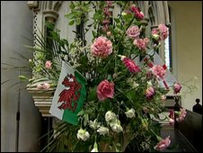 Flowers and Welsh flag at St Mary The Virgin Church in Dover