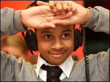 School Reporter wearing headphones