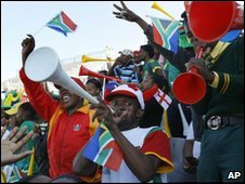 Fans watching an England practice game in South Africa