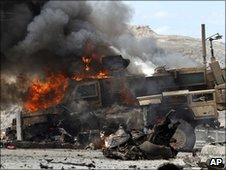 A Nato vehicle burns after a militant attack in Jalalabad, Afghanistan, 6 June 2010