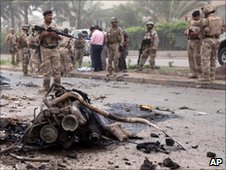 The site of a car bomb in Baghdad