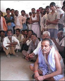 Villagers meet at Dihayla village in the sanctuary area