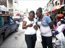Women using mobile phone in Haiti