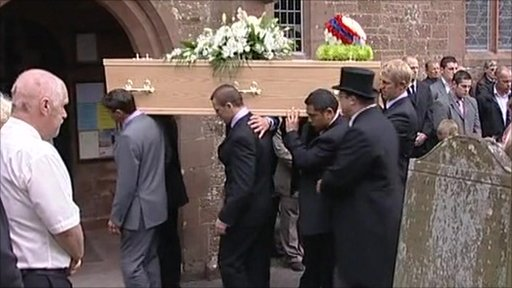 The coffin of Garry Purdham is carried into church