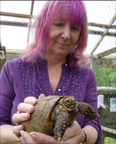 Joy Bloor with a tortoise