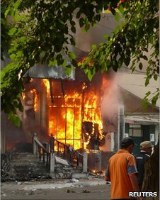A building burns in Osh in Kyrgyzstan on 11 June, 2010