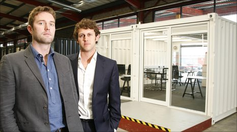 Christian Hill and James Coop outside their shipping container office
