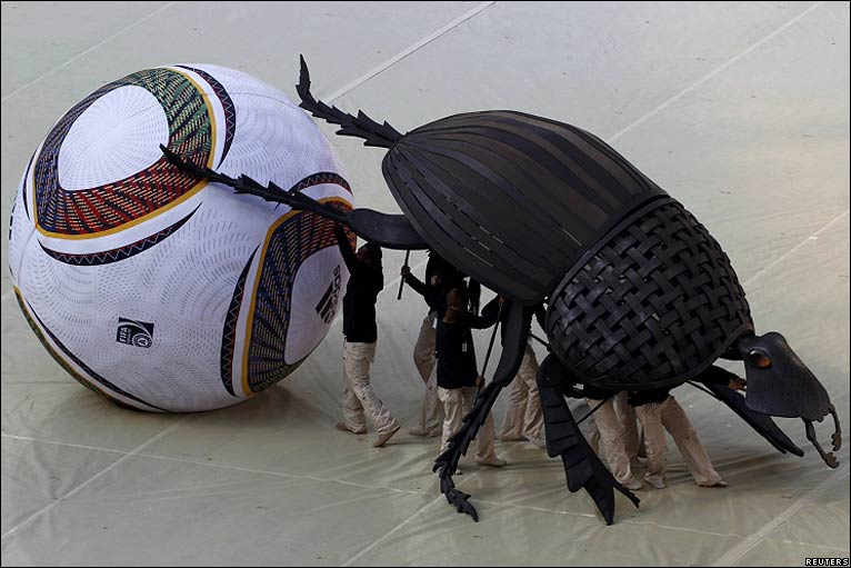 A giant dung beetle dribbles a World Cup football