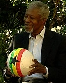 Former UN Secretary-General Kofi Annan holding a football