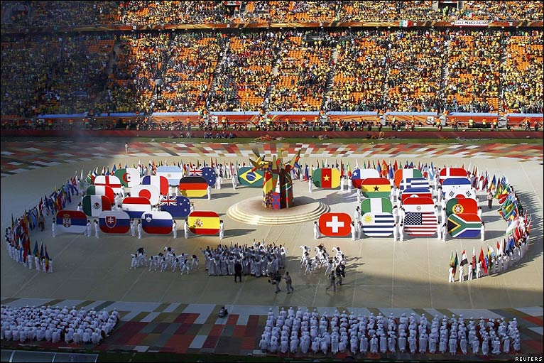 Flags of the 32 competing teams are revealed in the centre of the pitch