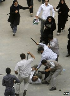 Iranian plainclothes policemen beat an election protester in Tehran, 14 June 2009